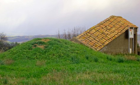 This photo shows one of the 2500 year old mounds beside the small modern that covers the stairs down to the tomb.