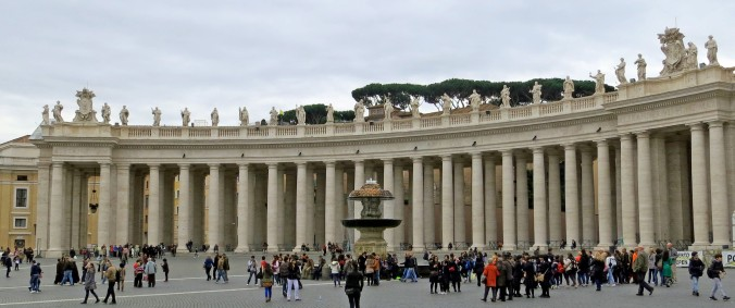 A view of St. Peter's Square featuring Bernini's columns that enclose the square.