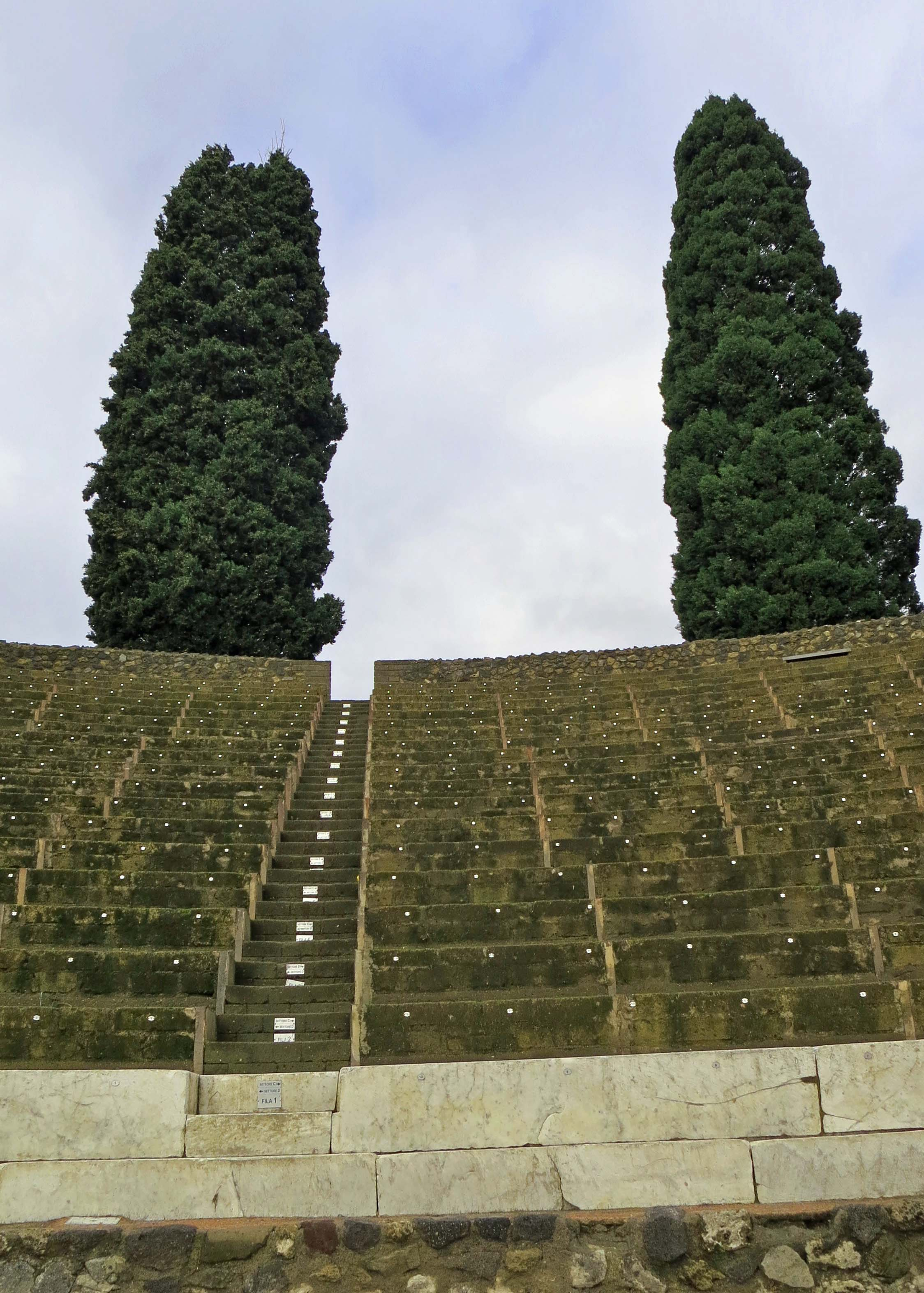Pompeii's theater, which could seat 5000 people, is located just beyond the gladiator school. Seats were separated by price and class. Poor folks got the nosebleed seats.