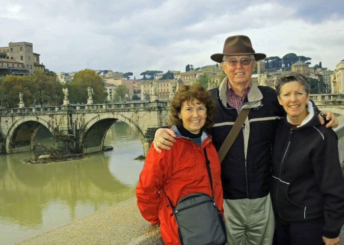 Peggy, her brother John and his wife Frances stand in front of the Tiber River and the Pont St. Angelo (the Bridge of Angels)