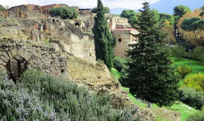 Buried under a pyroclastic flow of molten rock in 79 AD, the ruins of Pompeii have been well preserved. A large harbor on the Tyrrhenian Sea was located where the grass is now seen.