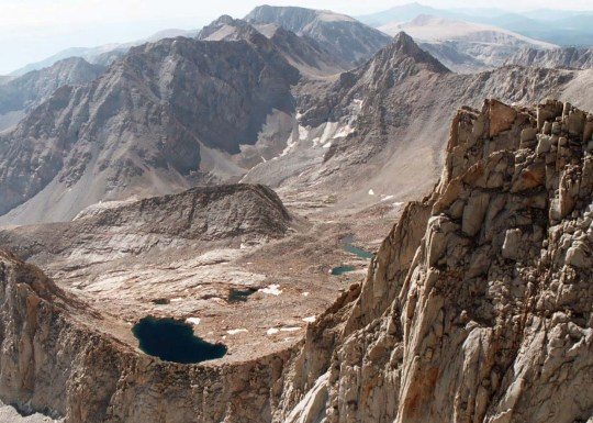 The perspective from the top of the 14,505 foot (4,421 meters) Mt. Whitney, the highest peak in the contiguous United States. Over the years I have taken many people to the top of this magnificent mountain including my son, Tony, and my nephew Jay, who was 16 at the time.