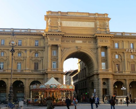 "The Piazza della Repubblica with its dominating arch. The message on it reads ""The ancient center of the City restored from age old squalor to new life."" It's what we call urban renewal when historical treasures are bull dozed down to make way for the modern. Much was lost."