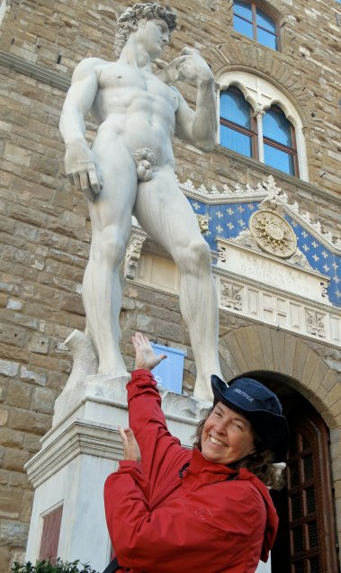Copy of Michelangelo's David standing in front of the Uffizzi  Art Gallery.