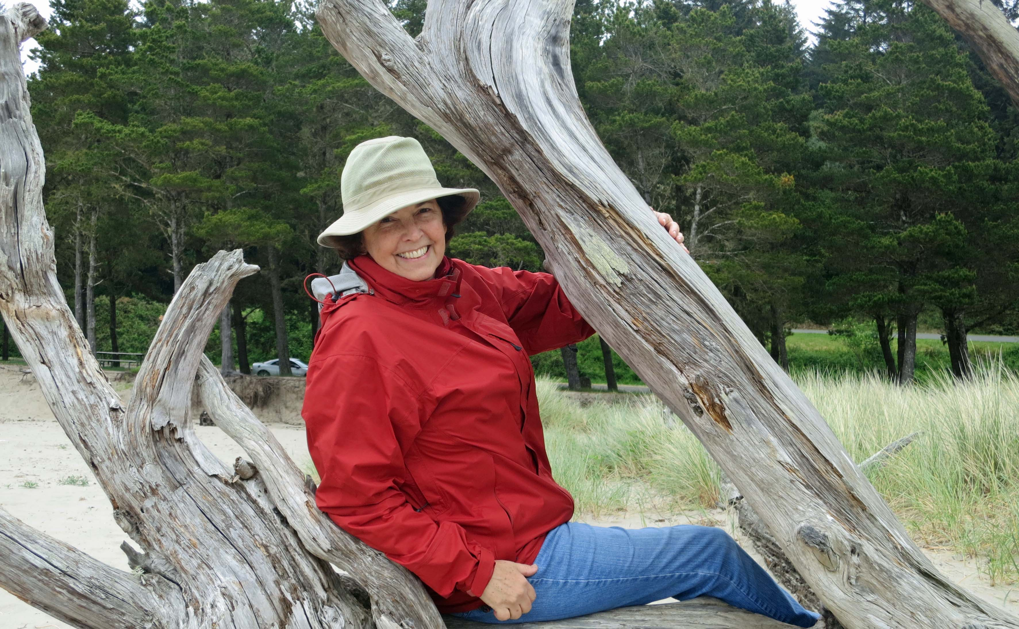 Peggy Mekemson and tree roots on Oregon Beach