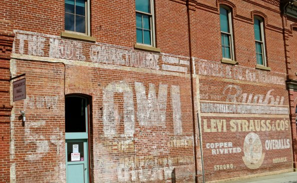 5 cent Owl cigar billboard on the side of Redmen's Hall in Jacksonville Oregon.