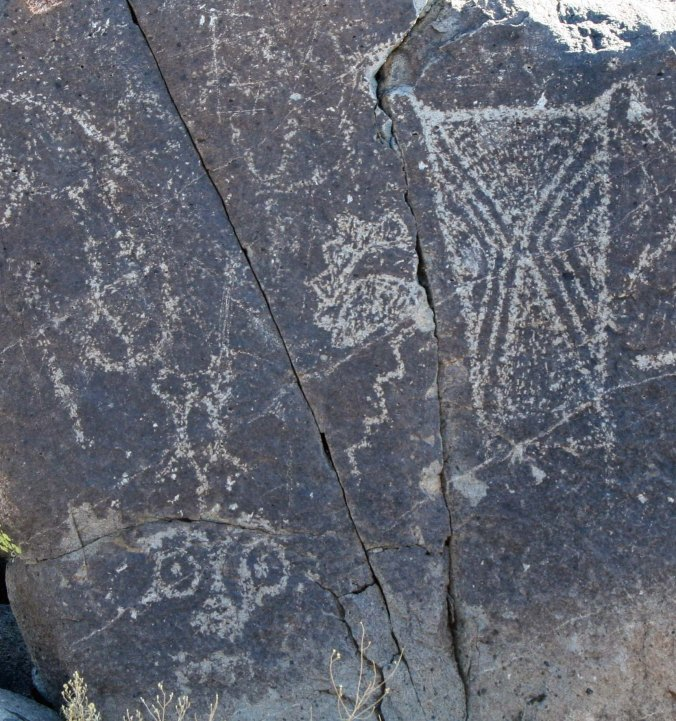 Cloud, lightning and sun petroglyph at Three Rivers Petroglyph site in New Mexico.