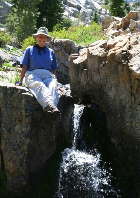 One of the first things I did when I met Peggy was introduce her to backpacking. (I took her on a 60 mile backpack trip.) Here she sits beside a small waterfall in the Five Lakes Basin.