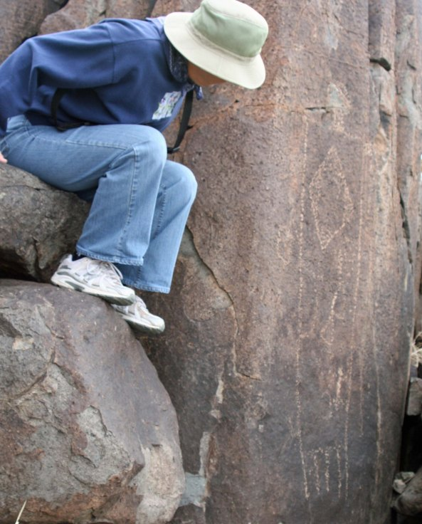 Peggy Mekemson checks out a petroglyph at Three Rivers Petroglyph site in southern New Mexico.