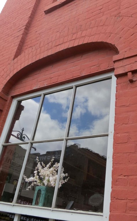 Window reflection photo in Jacksonville, Oregon.