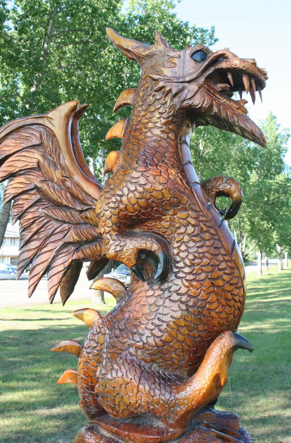 Peggy, who had just been kayaking on Dragon Lake in Quesnel, BC was immediately attracted to this dragon wood carving in Chetwynd.