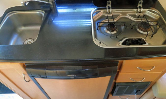 The kitchen: a two burner stove, the sink, and a refrigerator. What more do you need?  (grin)