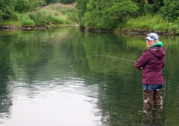 Cammie demonstrates her salmon fishing skills.