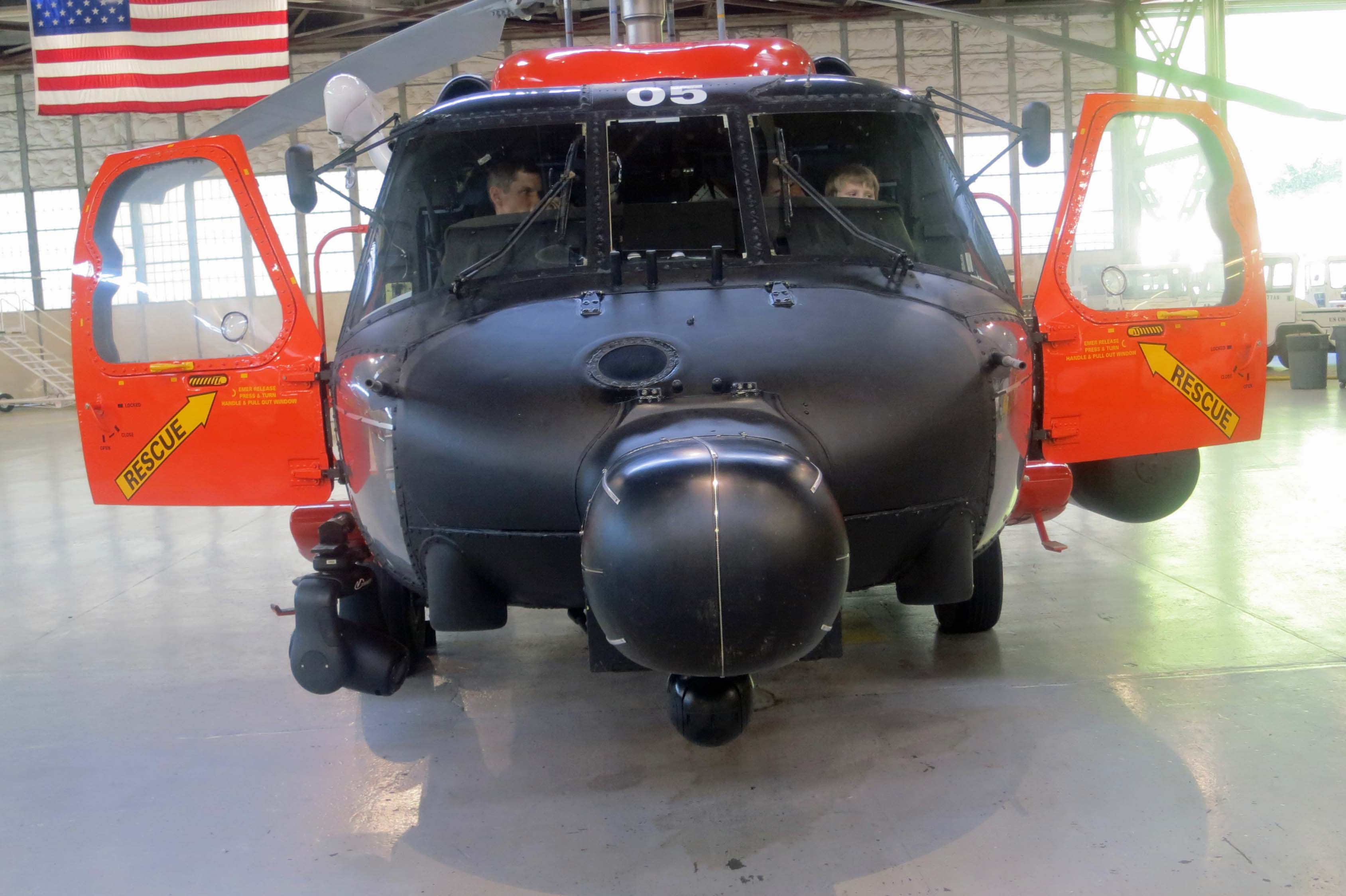 A front view of one of the Coast Guard's H-60s in the Hangar on Kodiak Island. Tony sits on the left in the picture while our grandson Connor sits on the right.