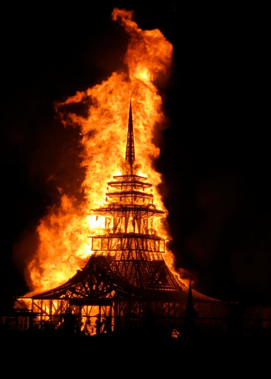 The burning of the temple on Sunday evening sends the messages skyward. Always noisy Burning Man, is silent for the burn.