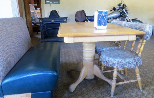 This dining set at the King Mountain Lodge was definitely reminiscent of those found in 50's diners, but what was with the Harley parked in the dining room?
