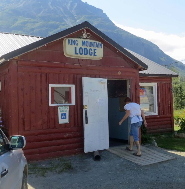 A hand printed sign at the King Mountain Lodge announced that food was available and we were hungry. In this photo, Darlene, the cook and owner's wife heads back inside after waving goodbye to us.