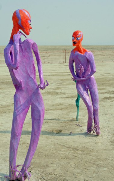 Two aliens in discussion at Burning Man 2013