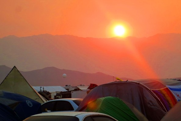 The sun sets on another day at Burning Man, a strange and sometimes wonderful event in the desert, guaranteed to challenge you concept of reality.