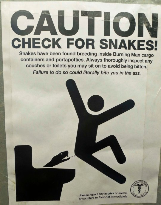 This sign warned Burners to be on the lookout for snakes that could be lurking down inside the potties.