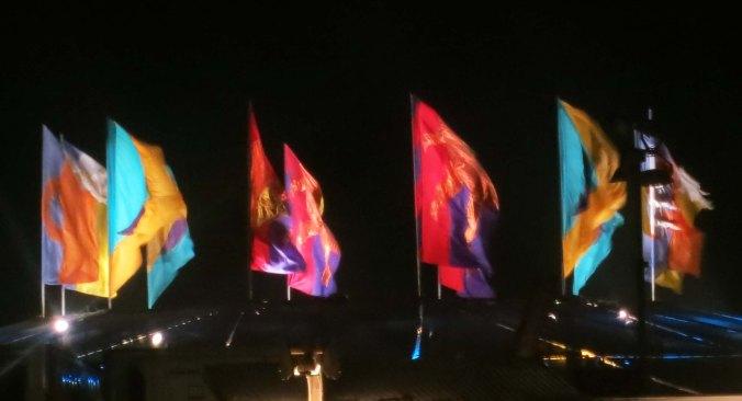 Burning Man Center Camp cafe flags at night.