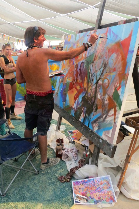 Painter works on canvas at Burning Man 2013.