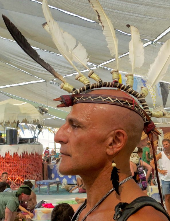 Feathers seemed to be in at Burning Man 2013. I really liked this profile shot I caught in Center Camp.