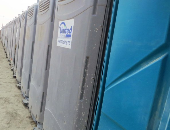 A long line of port-a-potties lined Sixth Street just down from our camp on G Street.