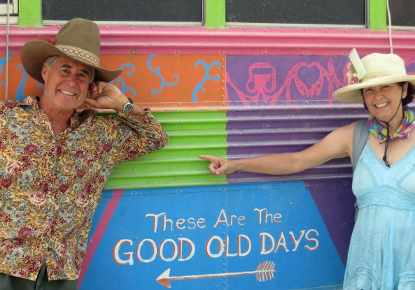 My wife Peggy, aka Luna, and friend Tom, aka Adios, pose in front of a sign on the front of the Purple Platypus Bus. These are indeed the good old days.