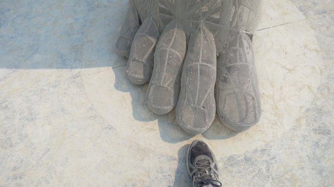The toes of the sculpture Truth Is Beauty at Burning Man 2013.