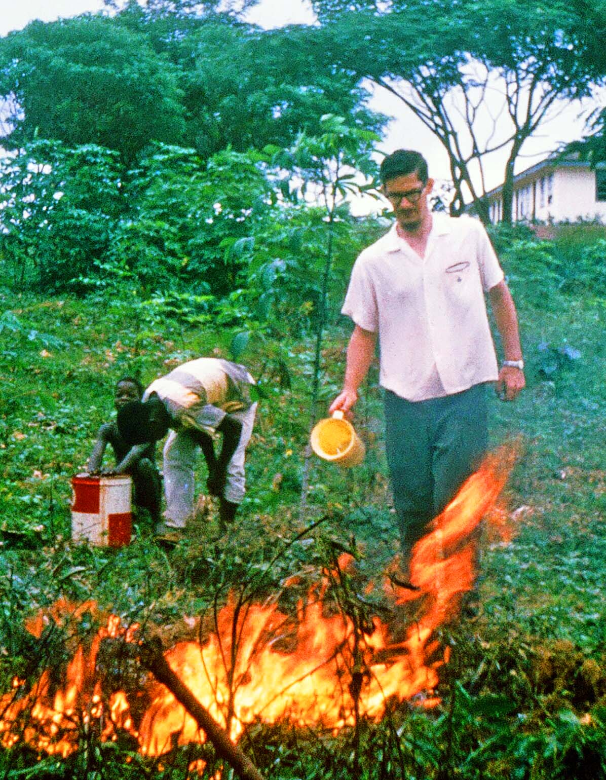 Burning out a nest of army ants in Gbarnga, Liberia circa 1966.