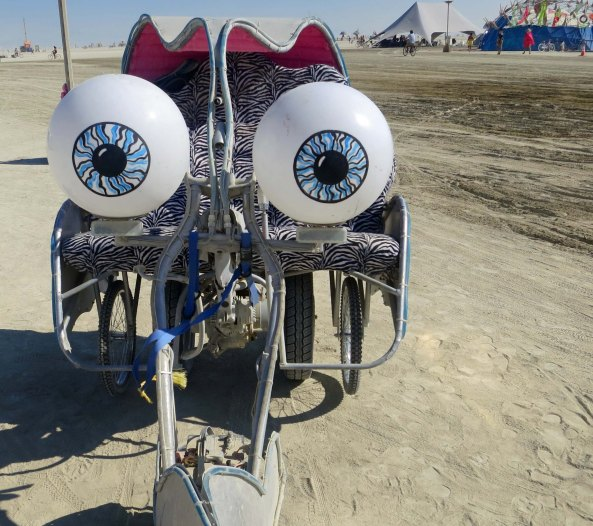 Mutant vehicle with huge eyes at Burning Man 13.