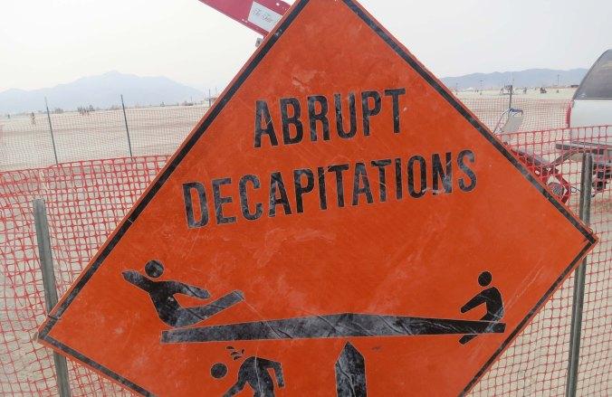 Decapitation warning sign at Burning Man.