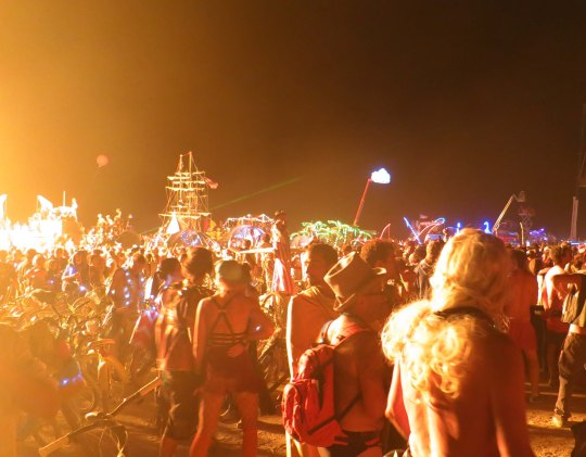 Flames from El Pulpo Mechanico light up the crowd that has gathered to watch the burning of the Man at Burning Man 2013.