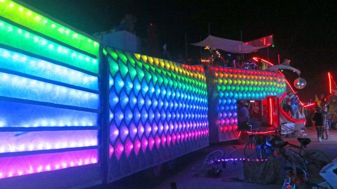 Colorful segmented mutant vehicle at Burning Man 2013.