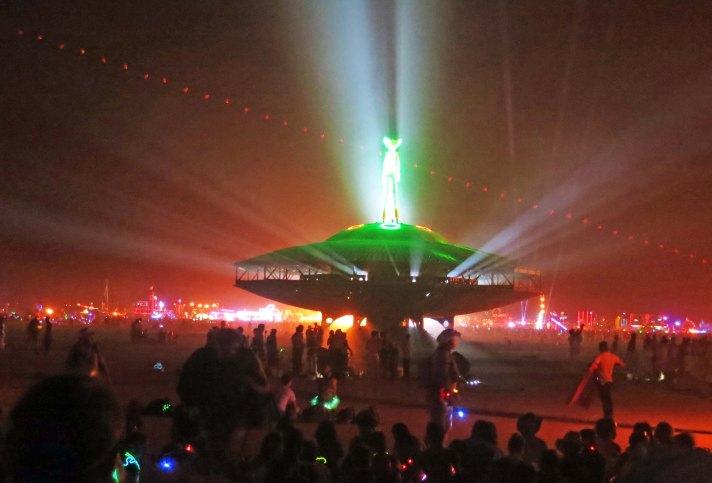 Burners gather to watch the Man burn at Burning Man 2013.