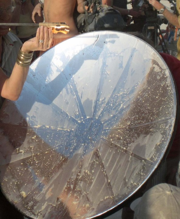A parabolic mirror is used to light the flame that will eventually light the Man. (Photo by Tom Lovering.)