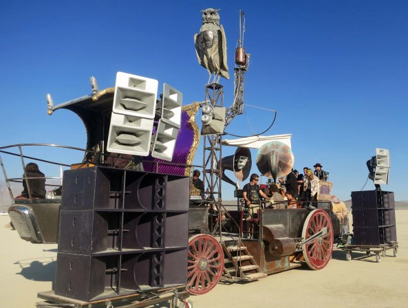 Mutant vehicle with a city of large speakers at Burning Man 2013.