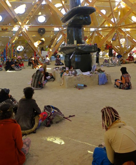 Black Rock City residents quietly meditate in the Temple of Whollyness at Burning Man 2013.
