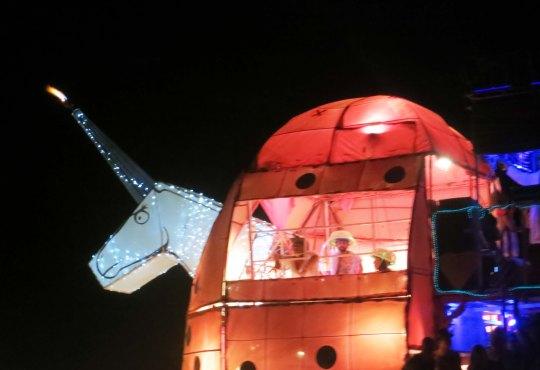 Unicorn mutant vehicle at night Burning Man 2013.