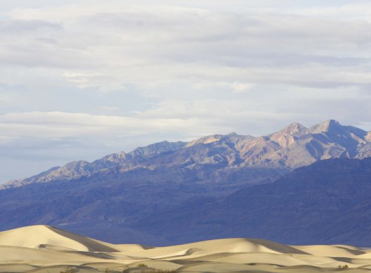Photo of sand dunes and mountains near Stove Pipe Wells in Death Valley by Curtis Mekemson.