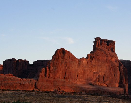 Evening sun turns a rock sculpture red in Arches National Park. Photo by Curtis Mekemson.