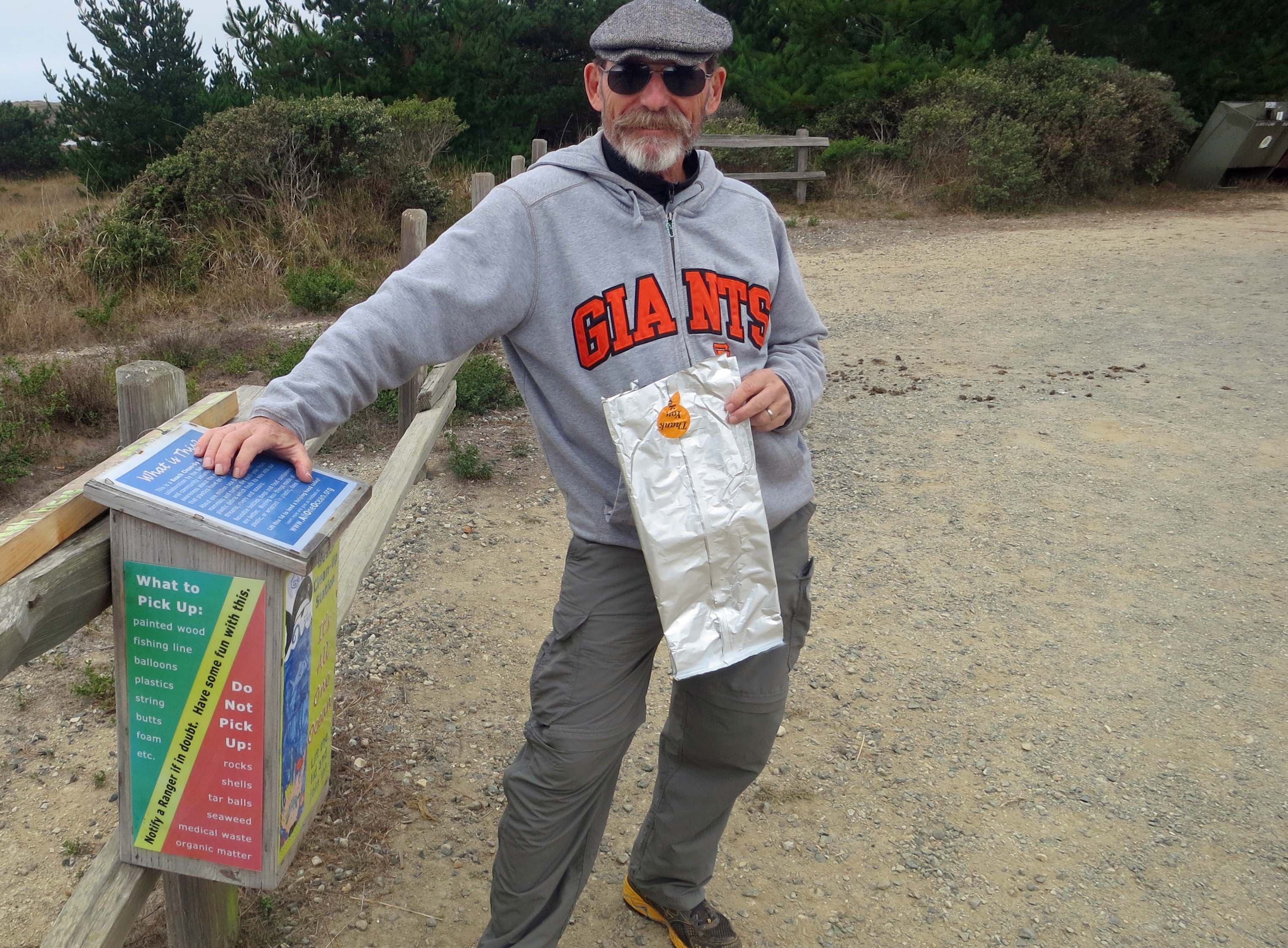 Bags provided for picking up trash on Limantour Beach at Pt. Reyes National Seashore. Photo by Curtis Mekemson