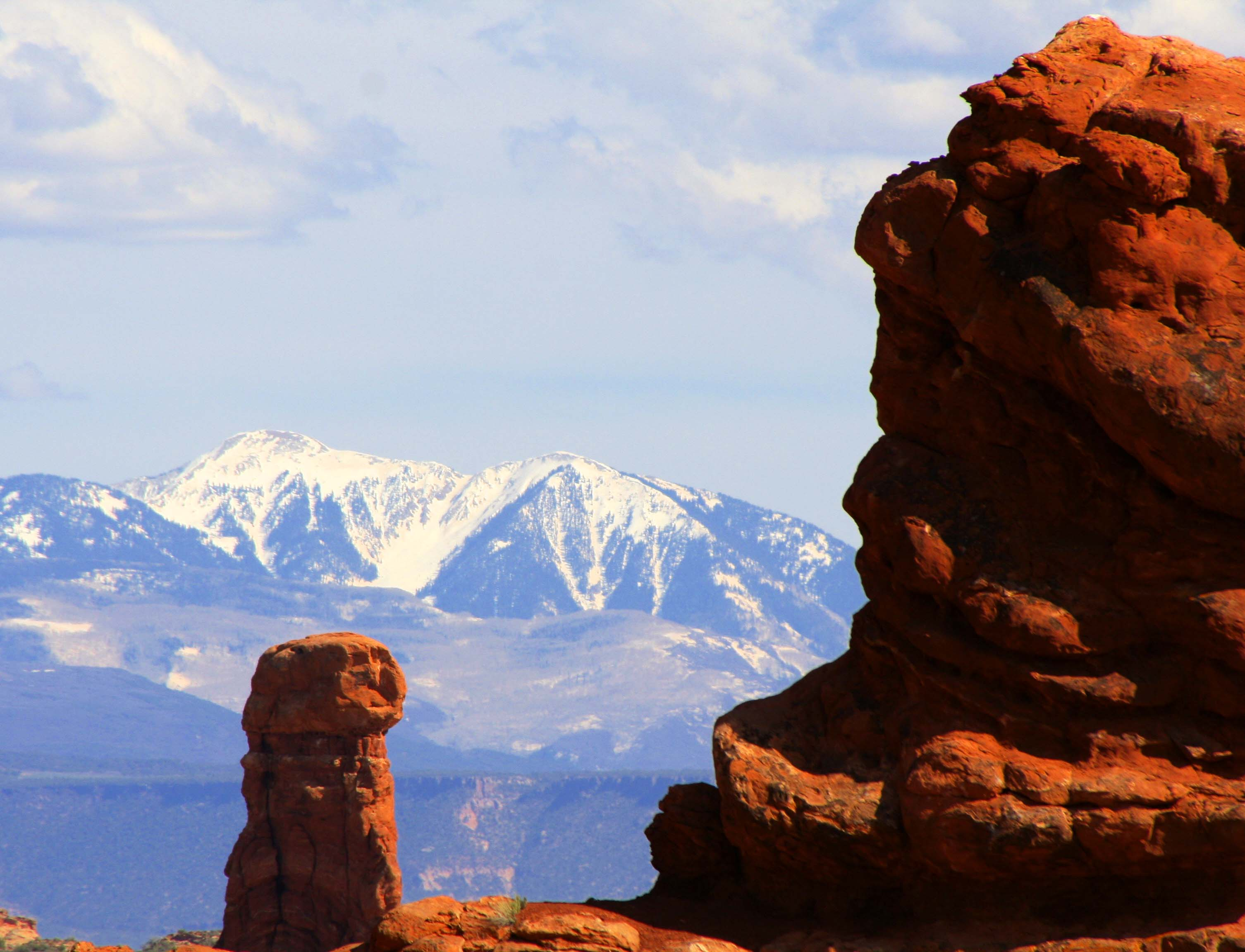 Photo of stone sculpture and mountains in Arches National park. Photo by Curtis Mekemson.