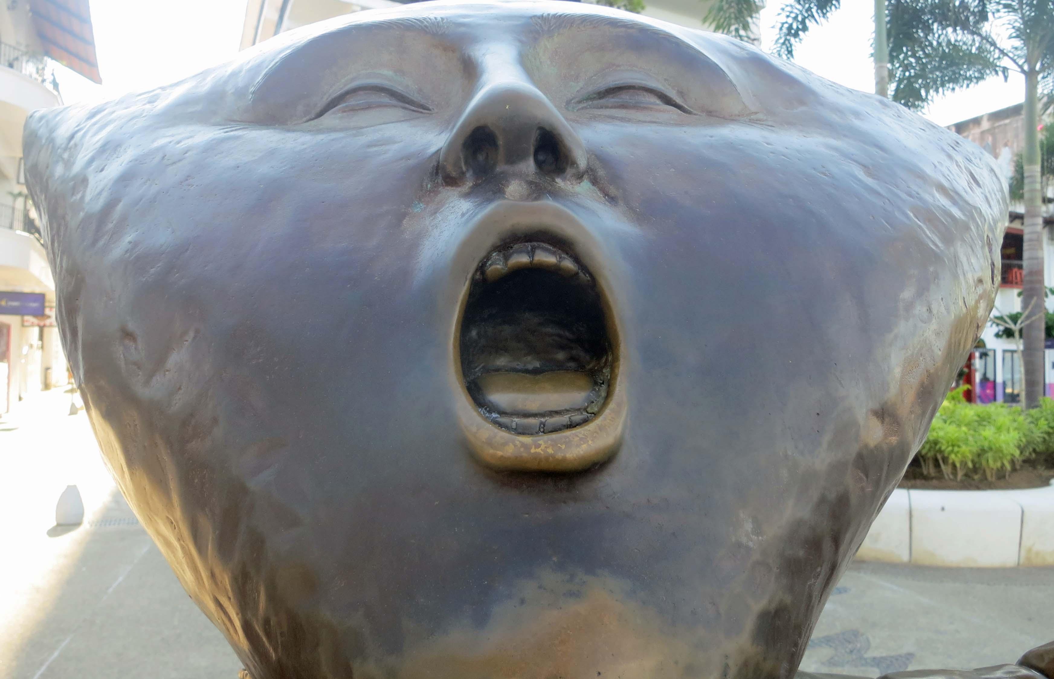 Sculpture in Puerto Vallarta by Sergio Bustamante in 1990. Photo by Curtis Mekemson.