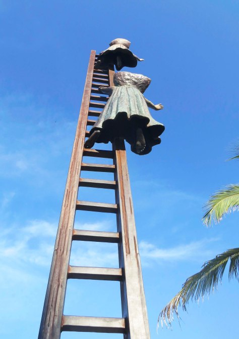 Sculpture in Puerta Vallarta by Sergio Bustamante. Photo by Curtis Mekemson.