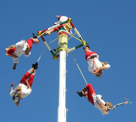 And then fall off backwards, twirling around the pole in ever larger circles until they reach the ground, or their rope runs out. (just kidding.) The people who perform this aerial feat every hour or so indigenous performers demonstrating an ancient cultural tradition of the Totonac tribe. (Photo by Peggy Mekemson.)