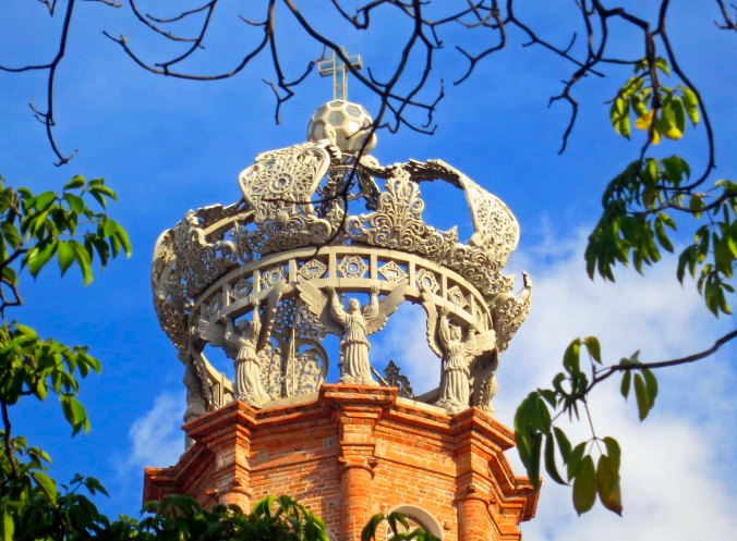 Photo of crown of the Church of Our Lady of Guadalupe in Puerto Vallarta,  Mexico. Photo by Curtis Mekemson.