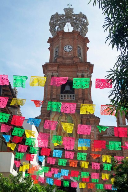 A view of the Church of Our Lady of Guadalupe through stree decorations in Puerto Vallarta. Photo by Curtis Mekemson.