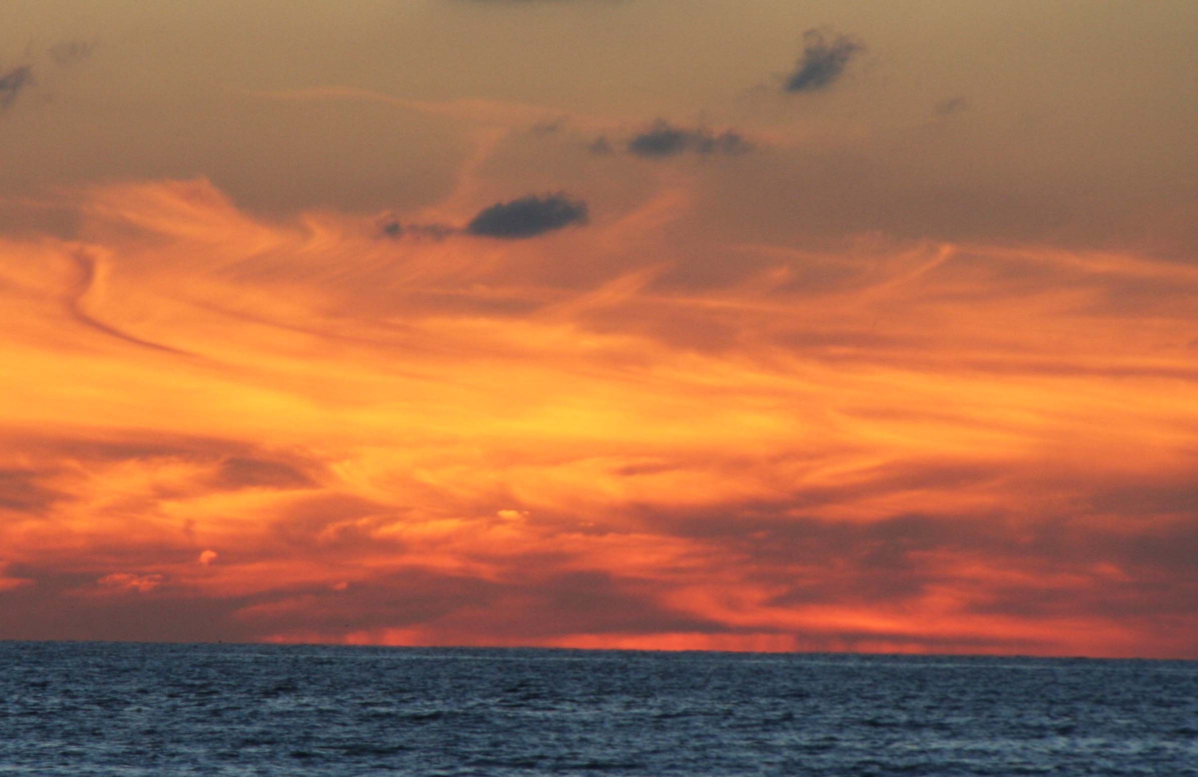 Sometimes the colors of a sunset are so vivid they seem unreal. (Photo by Peggy Mekemson.)